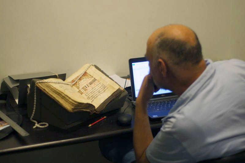 Figure 5. Youhanna Nessim Youssef cataloguing a Psalmodia.