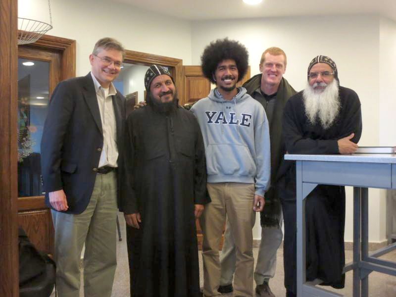 Figure 2. Members of the cataloguing team in the manuscript laboratory at Dayr al-Suryān (December 2014). From left to right, Mark Swanson, Father Azer, Cyril J. Uy III, Stephen J. Davis, and Father Bigoul.