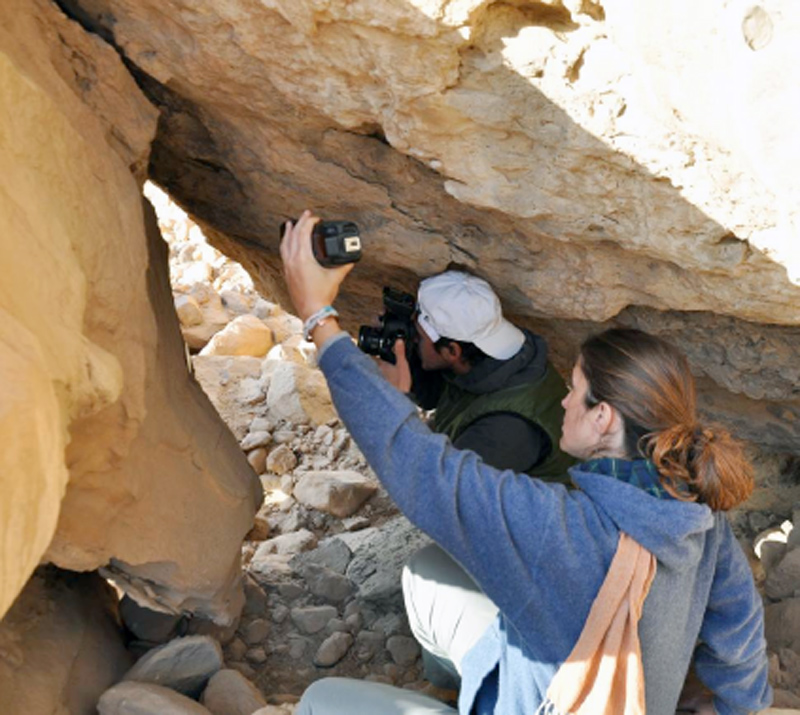 Figure 10 Photographing within the rock shrine at WH-3/EK 61