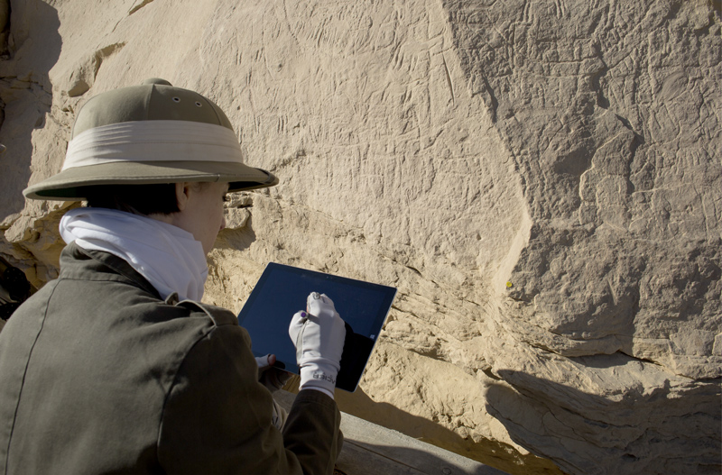 Figure 5 Using tablet computer on site to collate digital drawings of Panel 20a at the Borg el-Hamam rock inscription site (EK 77)