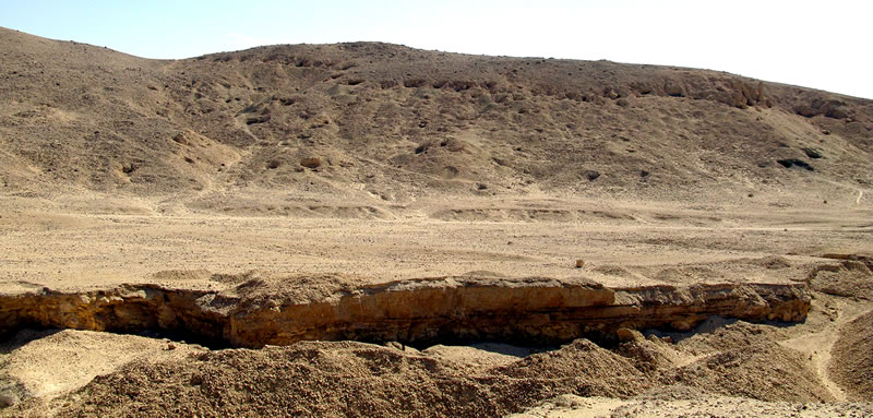 Figure 2 View (looking south) of Area H1, with openings of tombs visible along the upper portion of the cliffs and throughout the gebel.